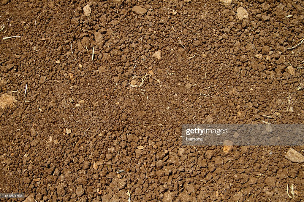 Close-up aerial view of coarse brown soil with no plant life : Stock Photo