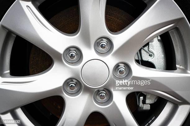 Closeup Alloy wheel rim with bolts