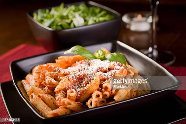 Close-up, angled shot of a pasta Bolognese