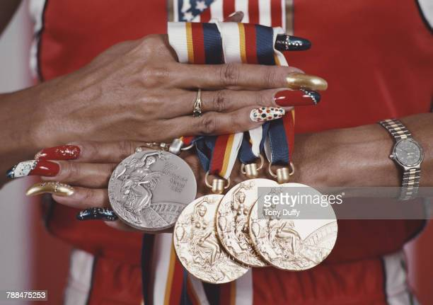 Close-up as American athlete Florence Griffith Joyner displays her medals from the Summer Olympic Games in Seoul, South Korea, September 25, 1988....