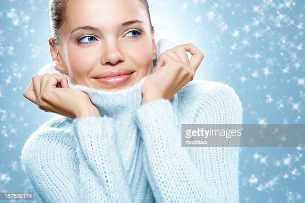 Close-up beautiful face of woman with white sweater