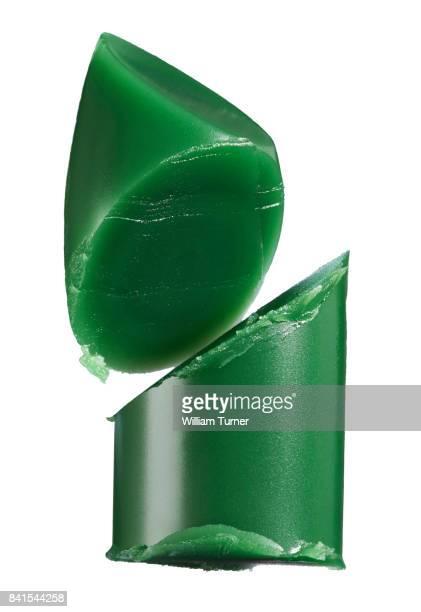 A close-up beauty image of a green lipstick