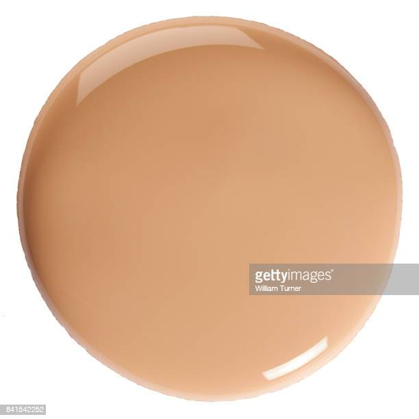 A close-up beauty image of flesh coloured foundation make up