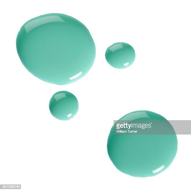 Close-up beauty images of drops of turquoise nail polish
