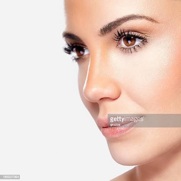 Close-up, beauty shot of a smiling, beautiful brunette woman