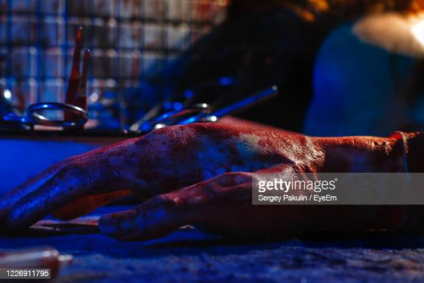 close-up blooded hand - crime and murder stock pictures, royalty-free photos & images