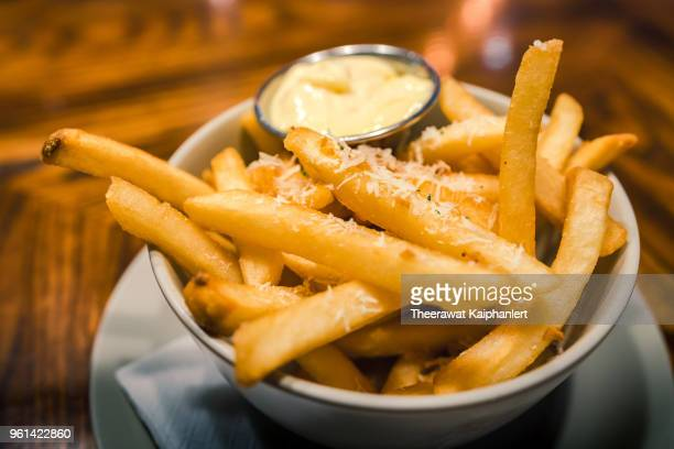 Close-up bowl of french fries with mayonnaise dipping