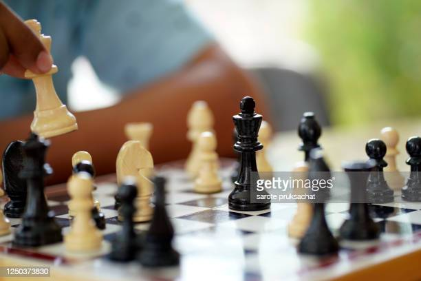 close-up businessman playing chess . - chess stock pictures, royalty-free photos & images