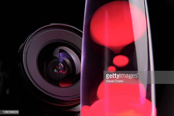 Close-up camera lens photographing amorphic red lava lamp shapes