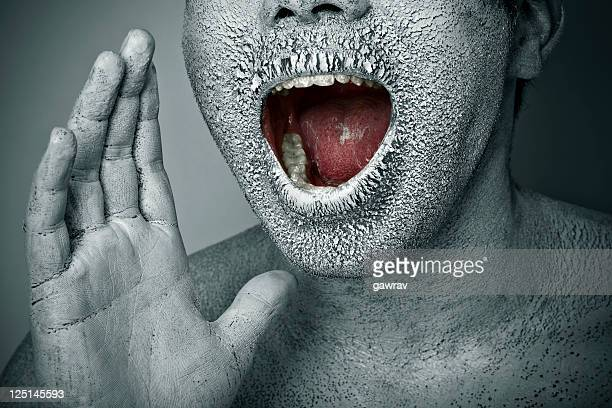 close-up, chapped, dry painted human face screaming with open mouth - dry mouth stock photos and pictures