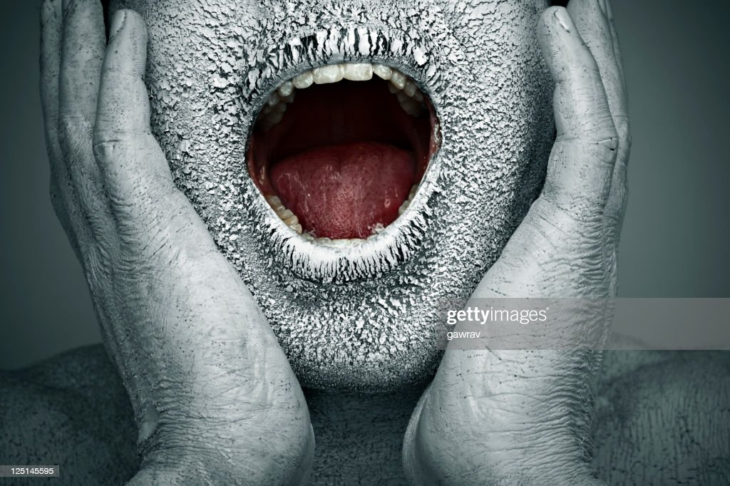 Close-up, chapped, dry painted human face screaming with open mouth : Stock Photo