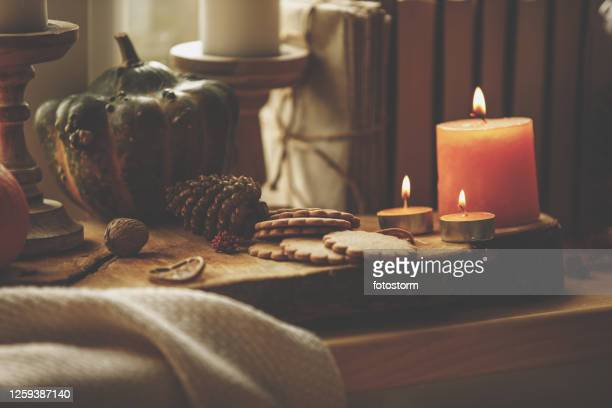 close-up composition of candles, cookies and pumpkin - embellishment stock pictures, royalty-free photos & images