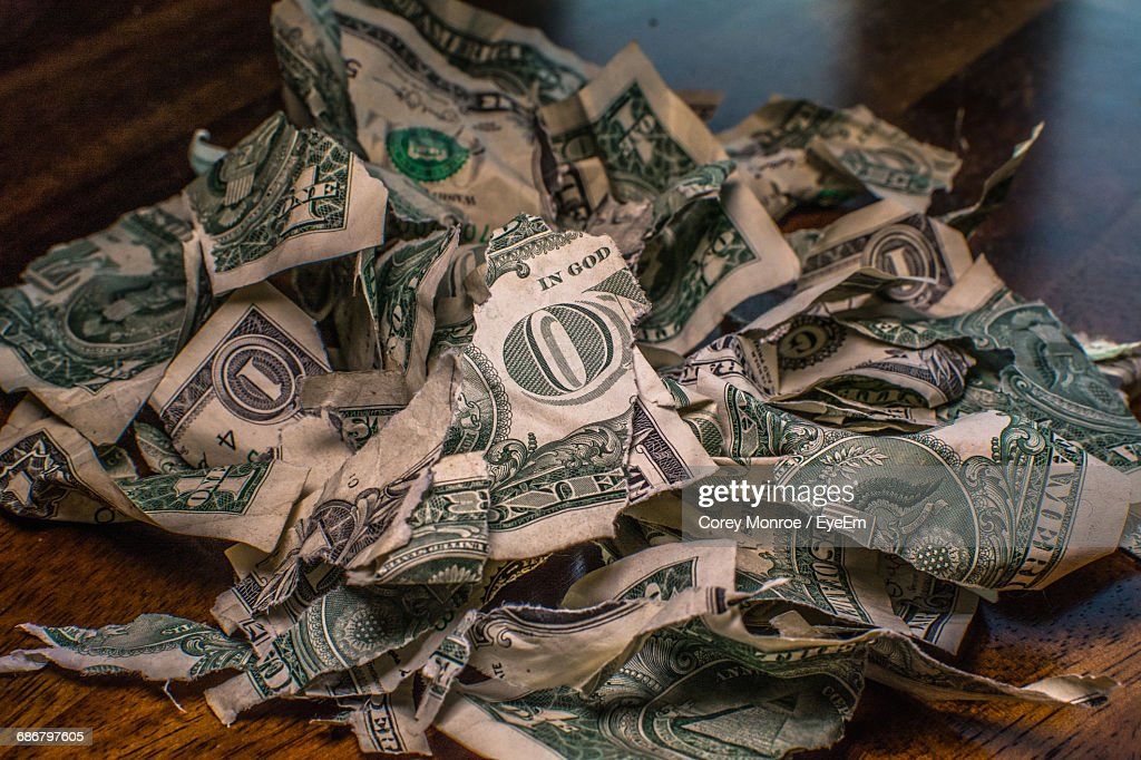 Close-Up Crumpled And Torn Us Paper Currency On Table : Stock Photo