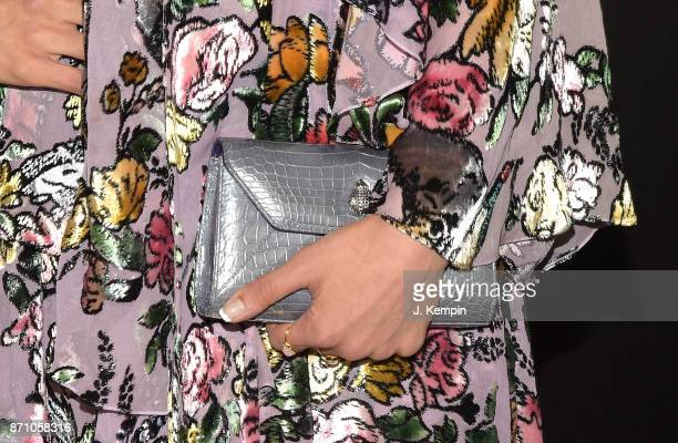 A closeup detail of actress Amber Rose Revah's clutch is seen at the 'Marvel's The Punisher' New York Premiere on November 6 2017 in New York City