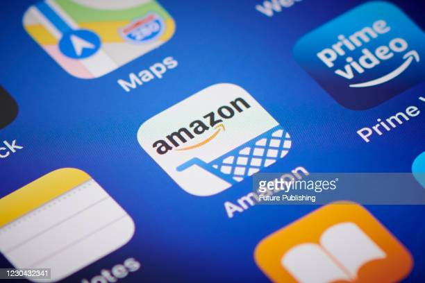 Close-up detail of the Amazon app icon on an Apple iPhone 12 Pro smartphone screen, on November 11, 2020.