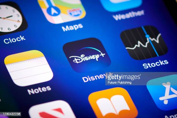 Close-up detail of the Disney+ app icon on an Apple iPhone 12 Pro smartphone screen, on November 11, 2020.