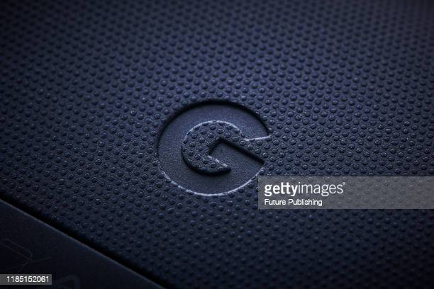 Closeup detail of the Google icon on a Google Stadia video game controller with a Night Blue finish taken on November 27 2019