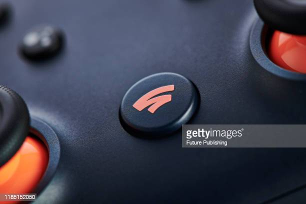 Closeup detail of the Home button on a Google Stadia video game controller with a Night Blue finish taken on November 27 2019