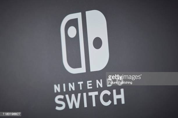Close-up detail of the logo on the back of a 2019 Nintendo Switch Lite handheld video games console with a Gray finish, taken on November 7, 2019.
