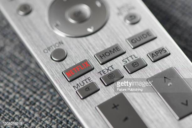 Close-up detail of the Netflix button on a television remote control, taken on March 6, 2020.