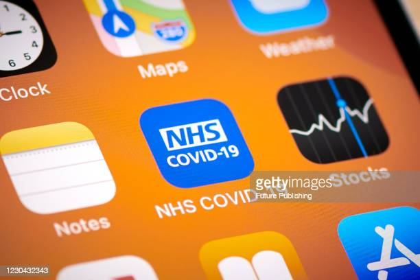 Close-up detail of the NHS COVID-19 app icon on an Apple iPhone 12 Pro smartphone screen, on November 11, 2020.