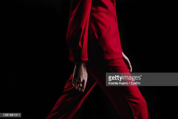 close-up details of clothing on a woman model in red suit walks on the fashion show - fashion week stock pictures, royalty-free photos & images