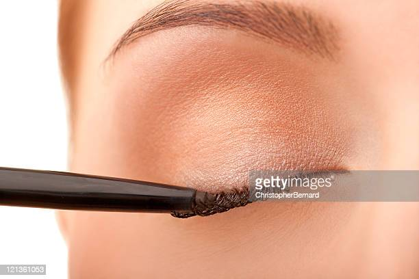 close-up female applying eye liner - eyeliner stock pictures, royalty-free photos & images