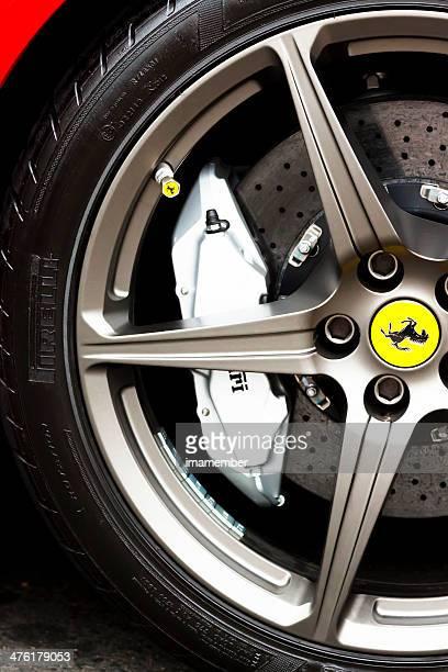 Closeup Ferrari alloy wheel with carbon ceramic brake