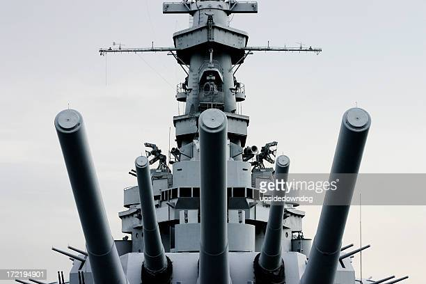 close-up front of battleship u.s.s. alabama with retro tint - warship stock pictures, royalty-free photos & images