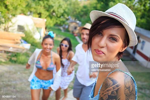 Closeup girl with tatoo and hat