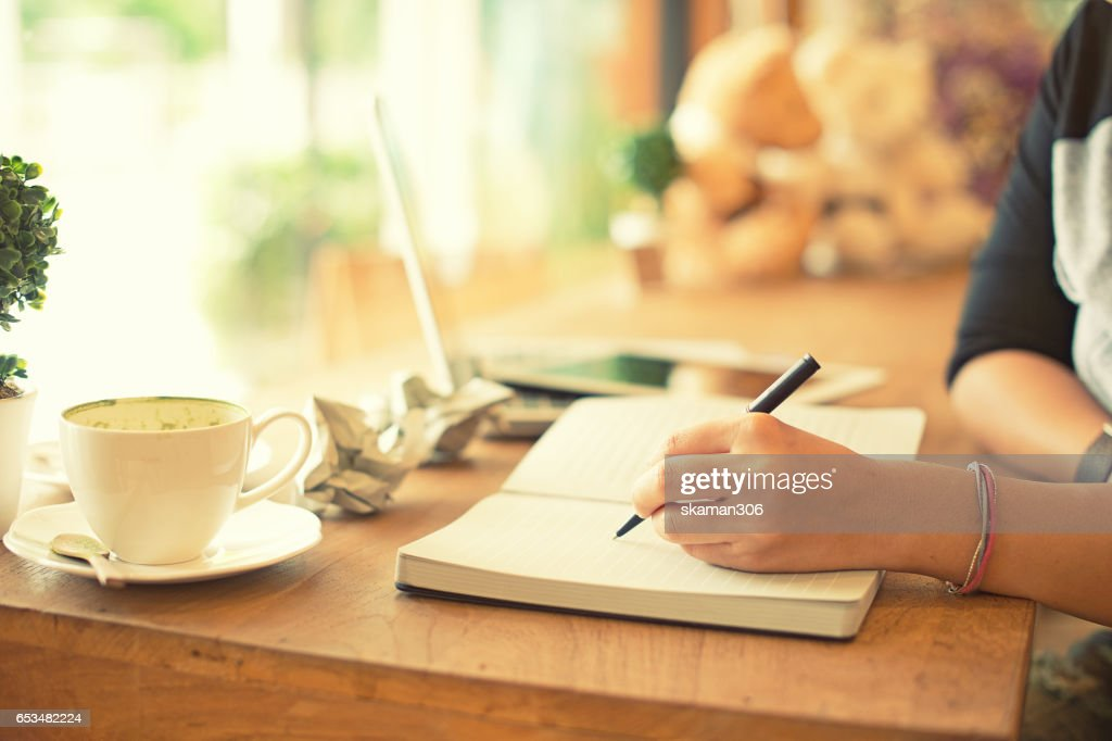 Close-up hand Of Male Architect Drawing Blueprint on work space wooden table in offfice : Stock Photo
