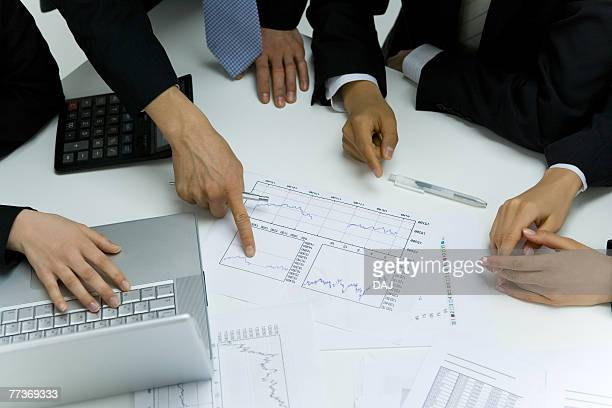 close-up hands of businessmen, high angle view - medium group of objects stock pictures, royalty-free photos & images
