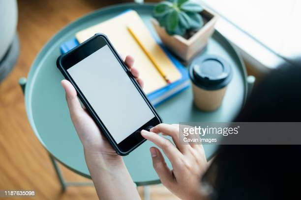 closeup hands using smartphone mockup at the office desk. - template stock pictures, royalty-free photos & images