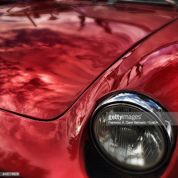 Close-Up Headlight Of Red Car