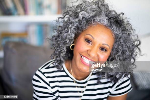closeup headshot of a beautiful black woman - pretty older women stock pictures, royalty-free photos & images