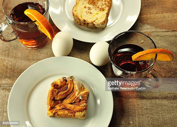 close-up high angle view of food and drinks on table - nathalie pellenkoft stock pictures, royalty-free photos & images