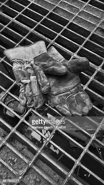 Close-Up High Angle View Of Gloves On Grill