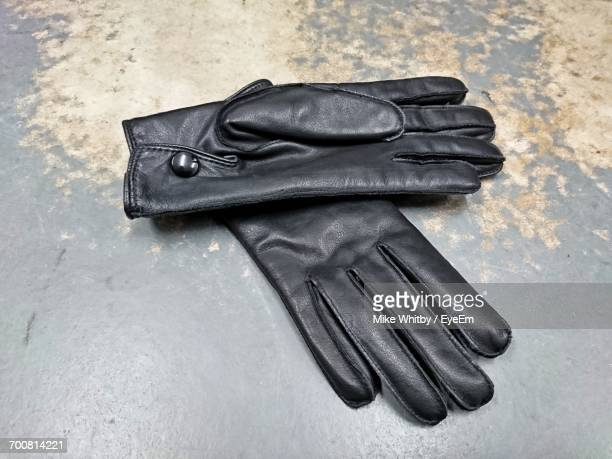 Close-Up High Angle View Of Leather Gloves