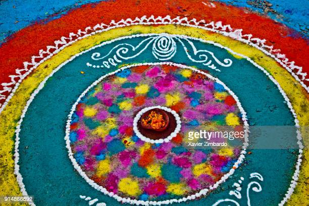 Closeup high angle view of Rangoli painted with colorful gulal powder directly on the floor during the Maha Kumbh Mela on February 13th 2013 at...