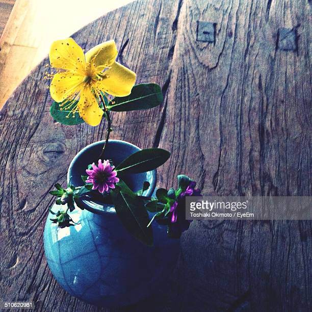 Close-up high angle view of vase on wooden table