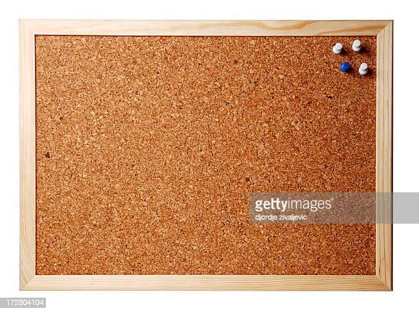 Close-up image of a framed corkboard