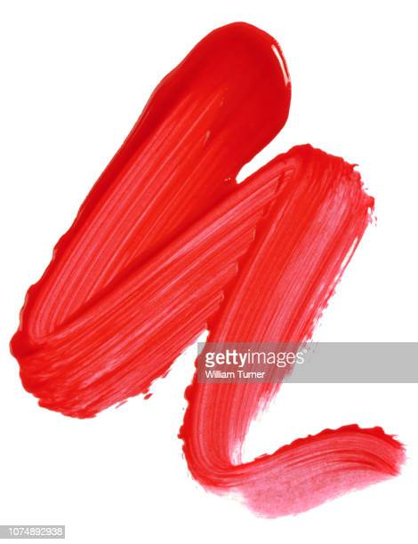a close-up image of a sample of red lip gloss on a white background - lip gloss stock pictures, royalty-free photos & images