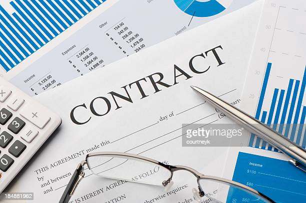 close-up image of contract form on a desk - employment law stock photos and pictures