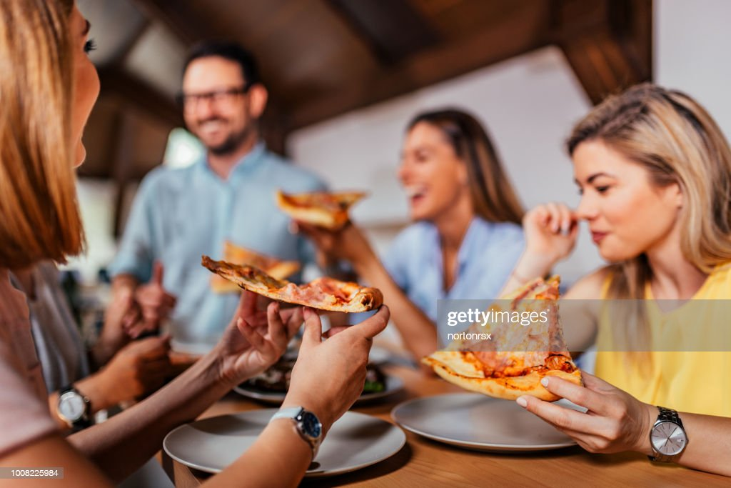 Close-up image of group of friends or colleagues eating pizza. : Stock Photo