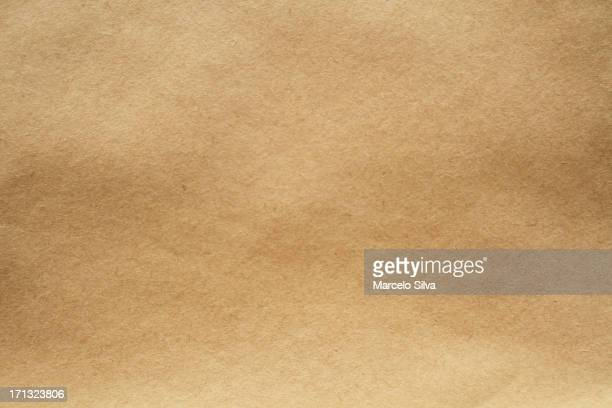 Close-up image of light brown paper texture