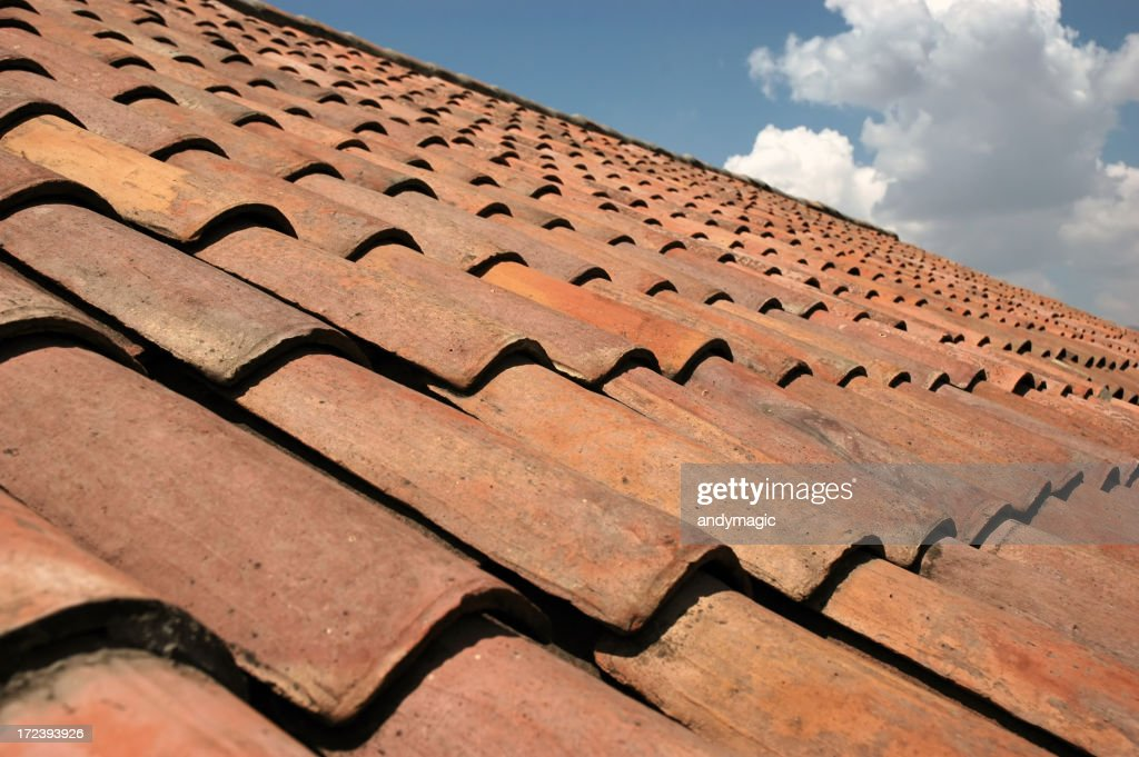 Closeup Image Of Red Roof Tiles Under A Blue Sky