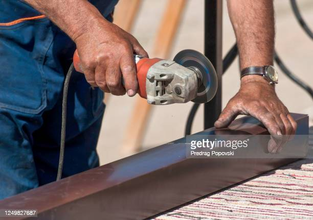closeup image of senior worker grinding gutter - kumanovo stock pictures, royalty-free photos & images