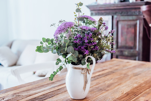 Close-up image of vase with lilac flowers on a wooden table (indoors) - gettyimageskorea