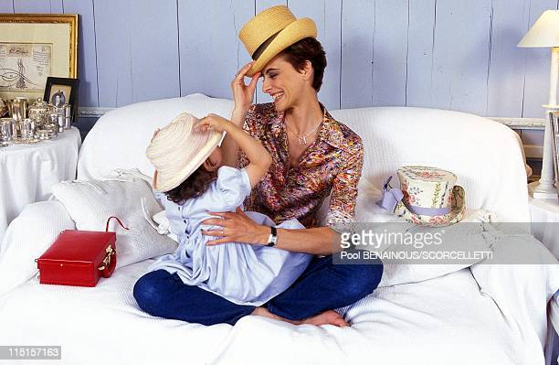 Closeup Ines de la Fressange in Paris France on July 16 1997 With her daughter Nine