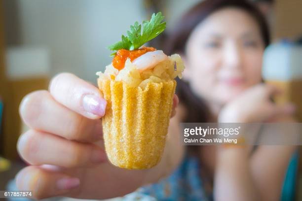 close-up kueh pie tee, a special nonya food pastry in asia - george town penang stock photos and pictures